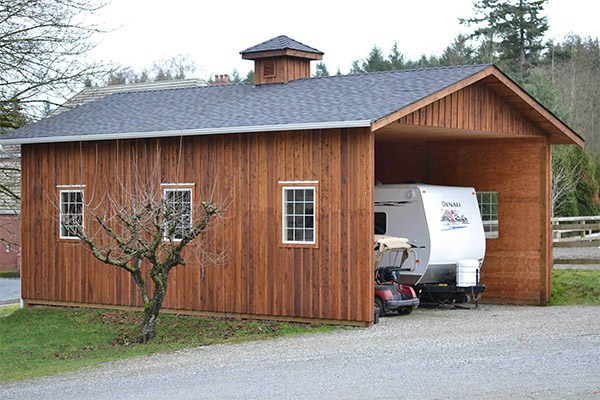 custom wooden storage shop garage shed with camper and golf cart inside
